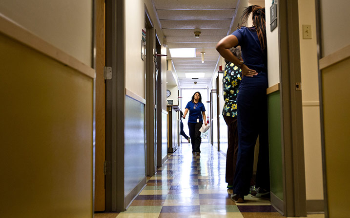 Medical staff check on patients at the People's Community Clinic in Austin, which provides state-subsidized women's health services to low-income women, on July 15, 2014. Photo by Callie Richmond.