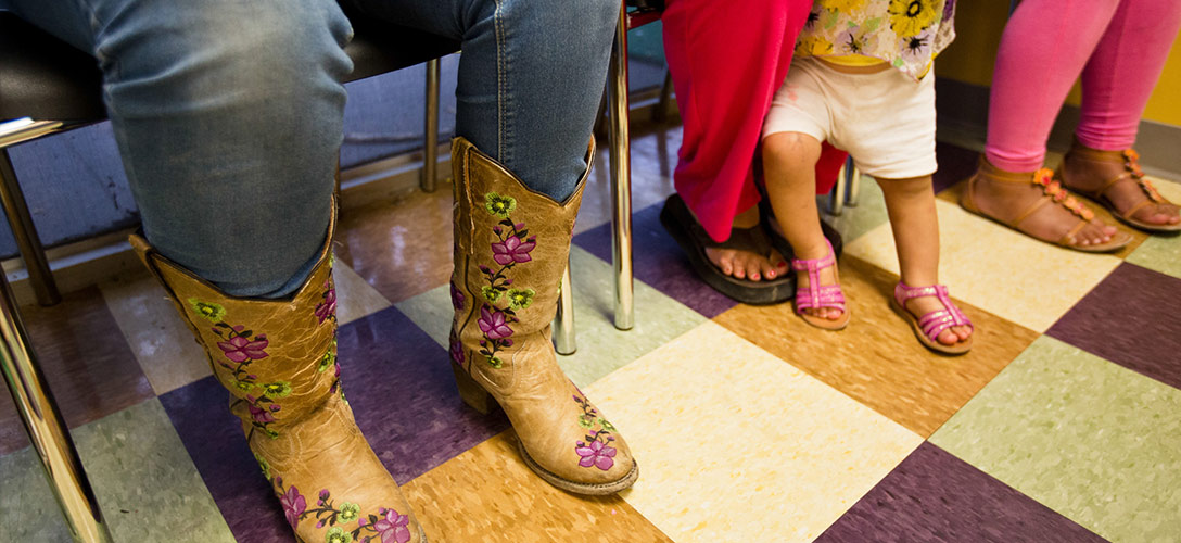 Patients wait to be seen at the People's Community Clinic in Austin, which provides state-subsidized women's health services to low-income women, on July 15, 2014. Photo by Callie Richmond.